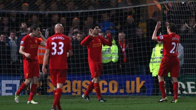 Football - Controversial Suarez goal seals tie