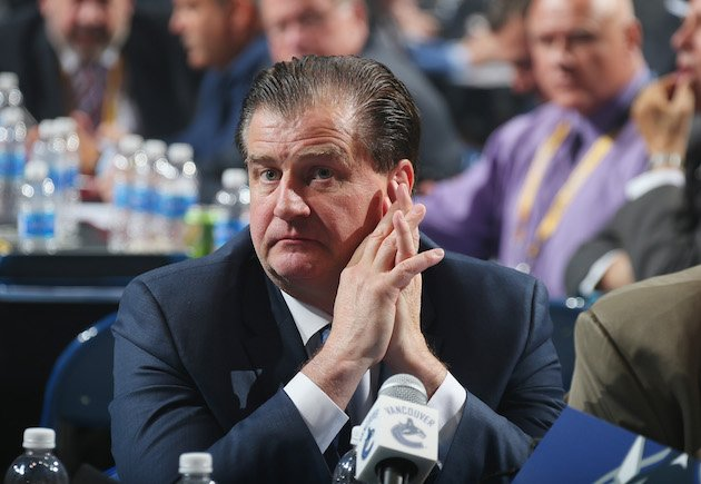 BUFFALO, NY - JUNE 24: Jim Benning of the Vancouver Canucks attends round one of the 2016 NHL Draft on June 24, 2016 in Buffalo, New York. (Photo by Bruce Bennett/Getty Images)