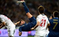 French forward Olivier Giroud (C) bicycle kicks during the friendly football match against Japan, on October 12, 2012 at the Stade de France in Saint-Denis, near Paris. Japan's 1-0 win was its first-ever victory against the 1998 World Cup champions in six games, following one draw and four defeats
