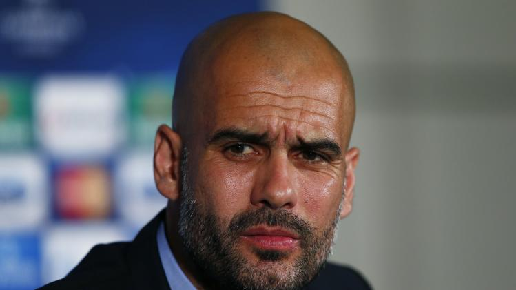 Bayern Munich's head coach Pep Guardiola attends a news conference at a hotel in London