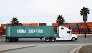 A truck pulls a trailer loaded with a China Shipping container at the Port of Oakland in California. China's trade surplus narrowed to $25.1 billion last month from $31.7 billion in June. That marked the second straight month that both exports and imports weakened