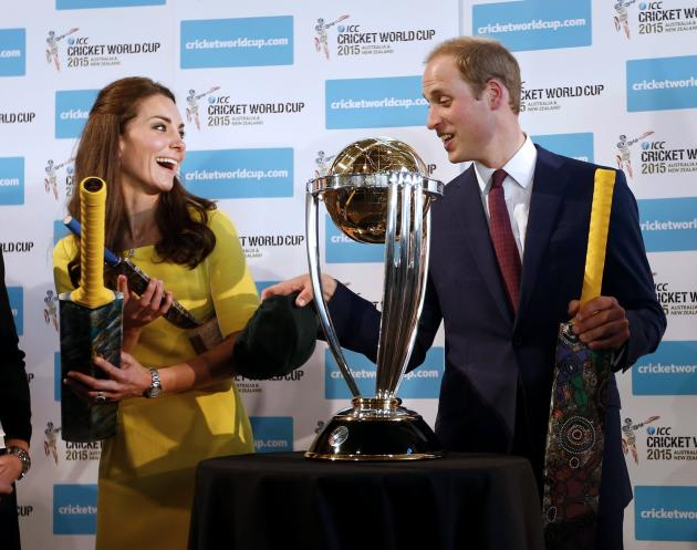 Britain's Prince William and his wife Catherine, Duchess of Cambridge, hold cricket bats during a reception at the Sydney Opera House