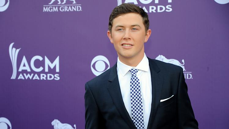 Musician Scotty McCreery arrives at the 48th Annual Academy of Country Music Awards at the MGM Grand Garden Arena in Las Vegas on Sunday, April 7, 2013. (Photo by Al Powers/Invision/AP)