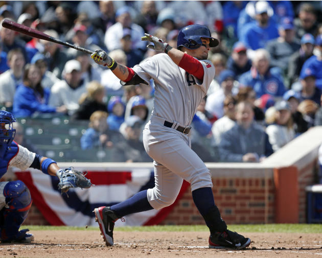 Arizona Diamondbacks' Gerardo Parra hits a single against the Chicago Cubs during the third inning of a baseball game at Wrigley Field in Chicago on Wednesday, April 23, 2014. (AP Photo/Andrew A.