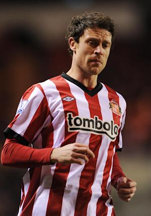 Wayne Bridge will spend next season at the American Express Community Stadium