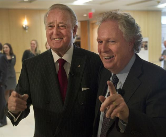 Former Prime Minister Brian Mulroney, left, arrives with former Quebec Premier Jean Charest at a tribute for Claude Ryan Friday, February 14, 2014 in Montreal.THE CANADIAN PRESS/Ryan Remiorz