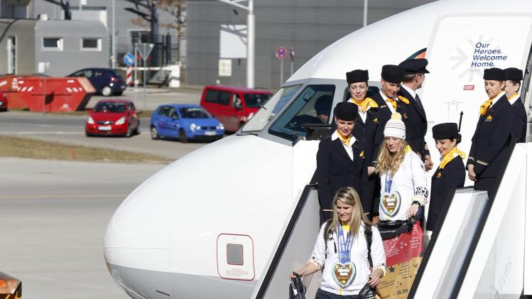 Germany's Loch is welcomed by German President Gauck during arrival of German Winter Olympics team 2014 at airport Munich