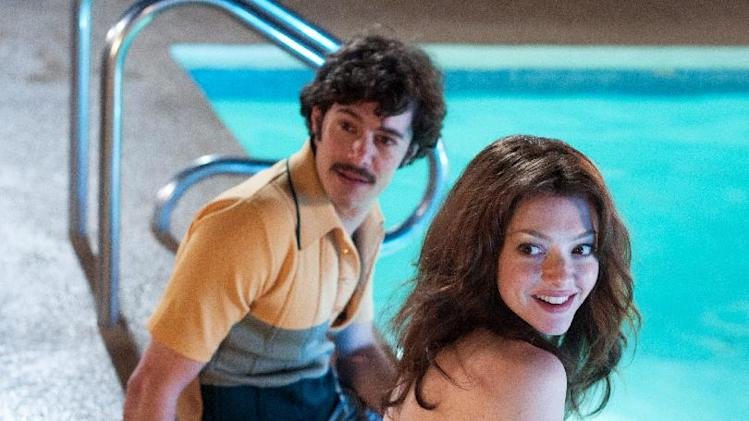 "This film publicity image released by RADIUS-TWC shows Adam Brody as Harry Reems, left, and Amanda Seyfried as Linda Lovelace in ""Lovelace."" (AP Photo/RADIUS-TWC, Dale Robinette)"