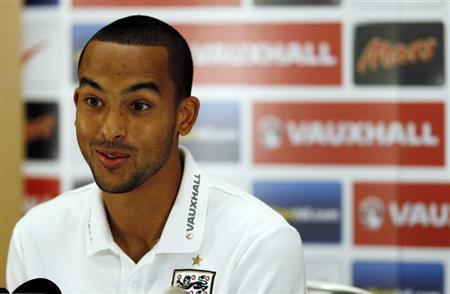 England's Walcott talks during a news conferenc at the St George's Park training complex near Burton upon Trent