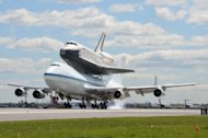 NASA's prototype space shuttle Enterprise touches down at New York's JFK International Airport on April 27, 2012.