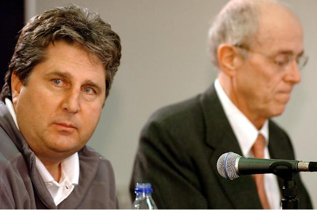 In this Feb. 19, 2009 file photo, Texas Tech football coach Mike Leach, left, listens during a news conference in Lubbock, Texas, as the university's chancellor, Kent Hance, explains the condition