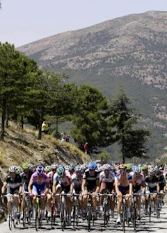 A pack of riders cycle during the fourth stage of the Tour of Spain