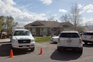 Authorities investigate a crime scene at a house in Pleasant Grove Utah, Sunday, April 13, 2014. According to the Pleasant Grove Police Department, seven dead infants were found in the former home of Megan Huntsman, 39. Huntsman was booked into jail on six counts of murder. (AP Photo/Daily Herald, Mark Johnston)