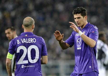 Fiorentina's Mario Gomez celebrates with teammate Borja Valero after scoring against Juventus during their Europa League round soccer match at Juventus stadium in Turin