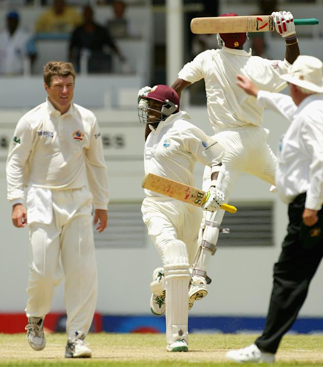 Vasbert Drakes of the West Indies celebrates the winning runs