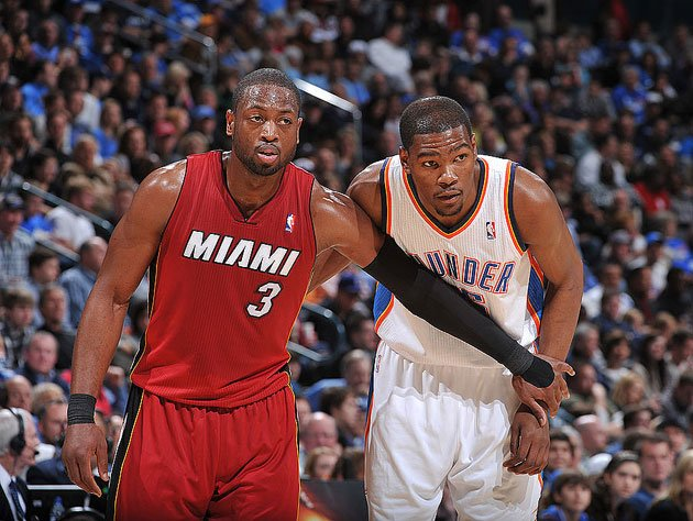 Dwyane Wade holds Kevin Durant back. (Getty Images)