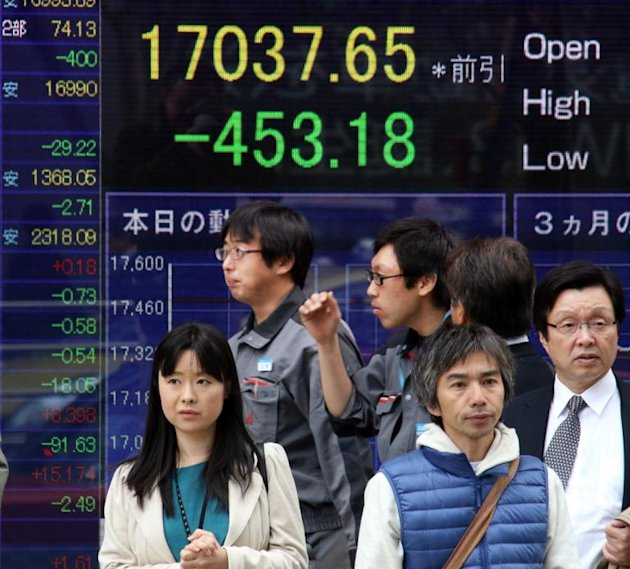 Asian markets mostly fall on Monday, with Tokyo tumbling almost three percent after data showing Japan's economy slipping into recession