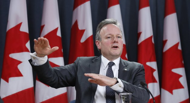 Bank of Canada Governor Stephen Poloz speaks during a news conference upon the release of the Monetary Policy Report in Ottawa January 22, 2014. REUTERS/Chris Wattie (CANADA - Tags: BUSINESS POLITICS)