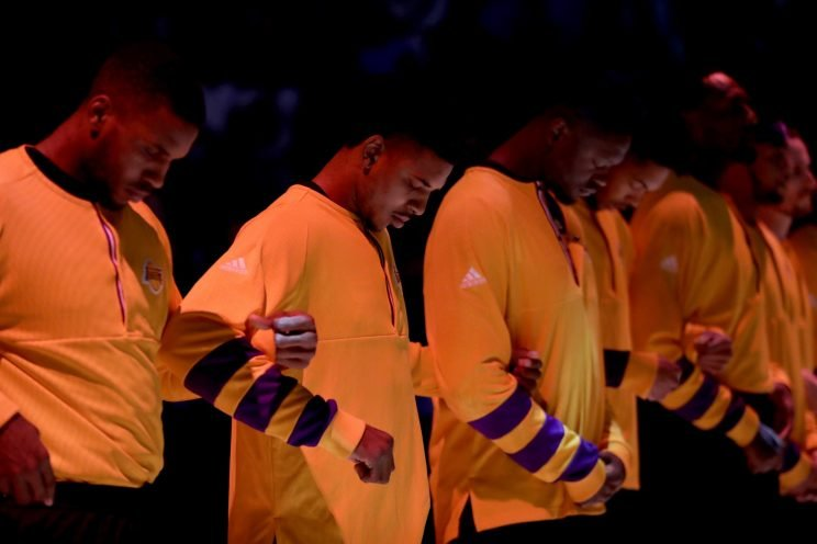 The Lakers were one of many NBA teams to lock arms in a show of unity during the national anthem early this season. (AP)