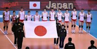 This file photo shows Japanese volleyball players listening to the national anthem before a match at the world women's volleyball championship in Tokyo, in 2010. Japan are hoping home advantage in the final Olympic women's volleyball qualifying tournament starting Saturday will help them secure a berth at London 2012 as they bid to end a 28-year medal drought