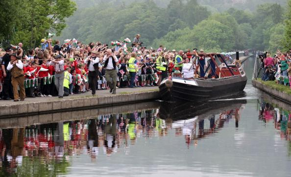 Joanne Gregory, Torchbearer 024, travels by barge across the Pontcysyllte Aqueduct with the Olympic Flame during the leg between Wrexham and Trevor in North Wales on day 12 of the London 2012 Olympic