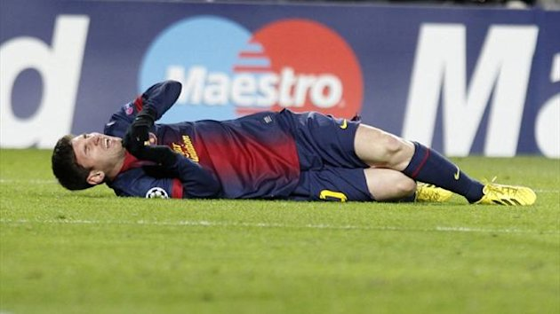 Barcelona's Lionel Messi lies prone after picking up an injury against Benfica in the Champions League (Reuters)