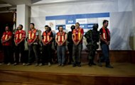 "Alleged members of the Pacific drug cartel --led by Joaquin Guzman Loera, aka ""El Chapo Guzman"", are presented to the press in Mexico City. Mexican security forces shot dead a top aide to the country's most wanted drug trafficker in a raid in a mountainous region of northern Mexico, defense officials said Monday"
