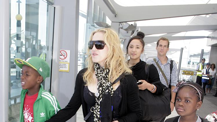 Madonna And Family Touch Down In London
