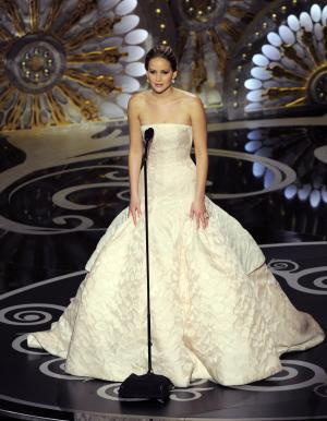 Jennifer Lawrence speaks onstage during the Oscars at the Dolby Theatre on Sunday Feb. 24, 2013, in Los Angeles.  (Photo by Chris Pizzello/Invision/AP)