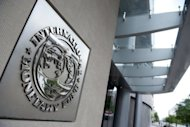 "The logo of the International Monetary Fund (IMF) at the organization's headquarters in Washington, DC. Teh IMF looks set to receive the $400 billion it needs to boost a ""global firewall"" and help stem Europe's debt crisis, Japan's finance minister said"