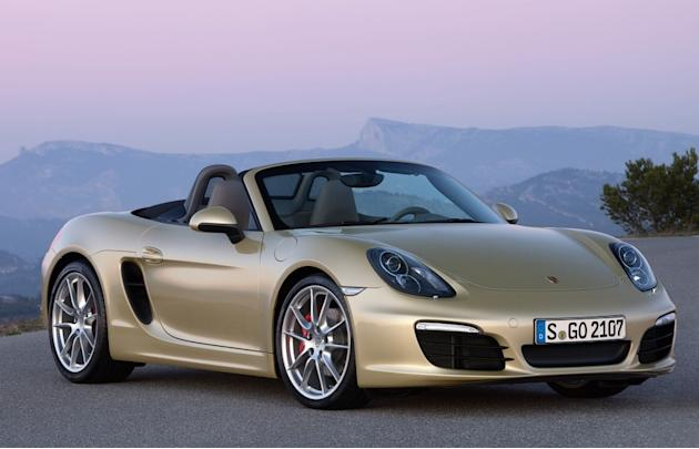 Porsche Boxster S: 	Porsche's push me-pull me looks for the Boxster convertible have never quite worked, but with design ideas snatched from the fabulous Carrera GT there's now an elegance and purpose