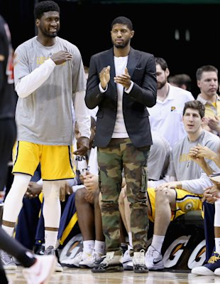 Paul George applauds his team's effort. (Photo by Andy Lyons/Getty Images)