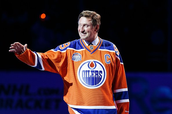 EDMONTON, AB - APRIL 6: Former Edmonton Oilers forward Wayne Gretzky greets fans during the closing ceremonies at Rexall Place following the game between the Edmonton Oilers and the Vancouver Canucks on April 6, 2016 at Rexall Place in Edmonton, Alberta, Canada. The game was the final game the Oilers played at Rexall Place before moving to Rogers Place next season. (Photo by Codie McLachlan/Getty Images)