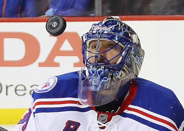 NEW YORK, NY - DECEMBER 06: Henrik Lundqvist #30 of the New York Rangers keeps his eyes on the puck during the second period against the New York Islanders at the Barclays Center on December 6, 2016 in the Brooklyn borough of New York City. (Photo by Bruce Bennett/Getty Images)
