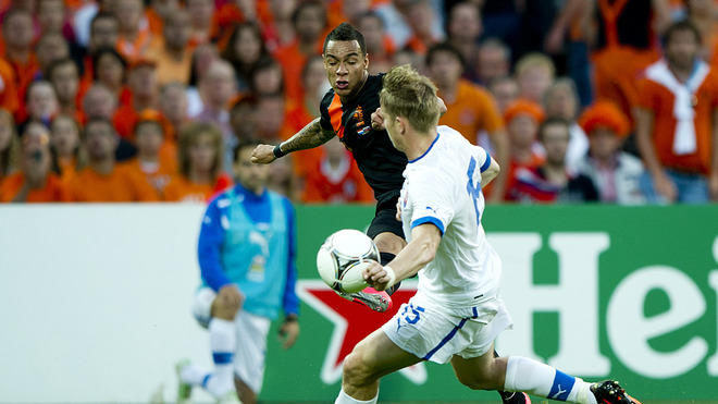 Gregory Van Der Wiel (l)  Of The Netherlands Fight For The Ball With  Thomas Hubocan  Of  Slovakia  AFP/Getty Images