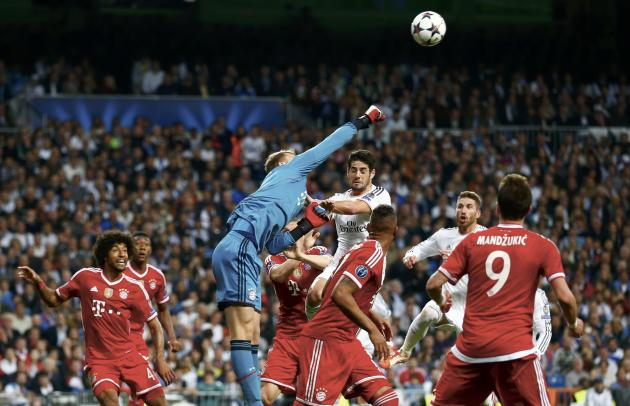 Bayern Munich's goalkeeper Neuer saves a high ball during their Champions League semi-final first leg soccer match against Real Madrid at Santiago Bernabeu stadium in Madrid