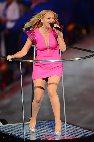 Emma Bunton performed in a bubblegum pink Maggie Cooke mini dress with sparkly shoulders and a plunging neckline. (Mike Hewitt/Getty)
