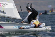 Australia's crew Mathew Belcher and Malcolm Page, foreground, celebrate after winning the gold medal of the 470 men's class sailing competition at the London 2012 Summer Olympics, Friday, Aug. 10, 2012, in Weymouth and Portland, England. (AP Photo/Bernat Armangue)