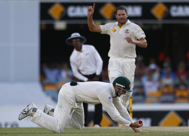Australia's Bailey takes a catch to dismiss England's Tremlett during the fourth day's play of the first Ashes cricket test match in Brisbane