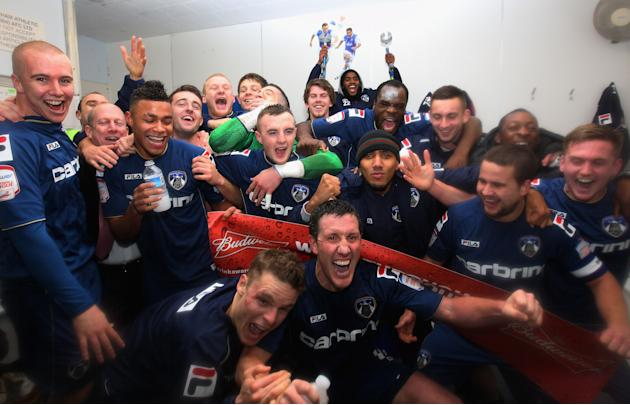 The Oldham players celebrate victory at the end of the FA Cup with Budweiser Fourth Round match between Oldham Athletic and Liverpool at Boundary Park on January 27, 2013 in Oldham, England. Photo by