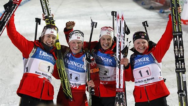 Hilde Fenne, Ann Kristin Aafedt Flatland, Tora Berger and Synnoeve Solemdal of Norway (R to L) celebrate their victory in the women's 4x6 km relay during the International Biathlon Union (IBU) World Championships in Nove Mesto (Reuters)