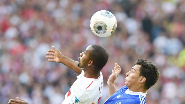 Stuttgart's Cacau, left, and Schalke's Kaan Ayhan  vie for the ball during the German Bundesliga soccer match between VfB Stuttgart and FC Schalke 04 at the Mercedes-Benz Arena in Stuttgart, Germany, April 20,2014