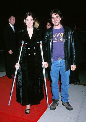 Premiere: Carrie Anne Moss and her dude at the Beverly Hills premiere of Miramax Films' Chocolat - 12/11/2000