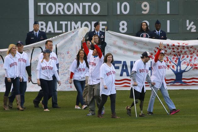2013 Boston Marathon bombings survivors Abbott and Bauman take the field during a pre-game ceremony before the MLB baseball game between Orioles and Red Sox at Fenway Park