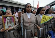Catholic nuns join some 7,000 protesters during an anti reproductive health (RH) bill rally at a Catholic shrine in Manila. Philippine nuns and priests led thousands of Catholics in a protest in Manila against a proposed law that would provide free contraceptives in a bid to curb population growth