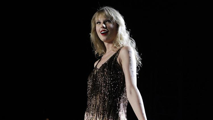 "FILE - In this March 2, 2012 file photo, Taylor Swift performs on stage at the Burswood Dome during the opening night of her ""Speak Now"" Australian tour in Perth, Australia. Multi-platinum selling superstar Taylor Swift is releasing her fourth studio album called ""Red"" on Oct. 22. (AP Photo/Theron Kirkman, File)"