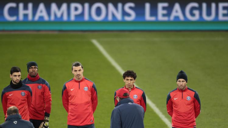 Paris St. Germain's coach Blanc gestures to his players during a training session in Leverkusen