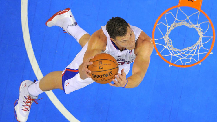Los Angeles Clippers forward Blake Griffin goes up for a dunk during the second half of an NBA basketball game against the Utah Jazz, Saturday, Feb. 1, 2014, in Los Angeles