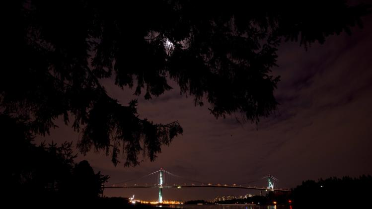 The lights on the Lions Gate bridge are off during Earth Hour as seen from West Vancouver, British Columbia, Saturday, March 23, 2013. (AP Photo/The Canadian Press, Jonathan Hayward)