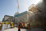A file photo, released by Gori Nuclear Power Site, shows a drill being performed to contain fire and radioactive leak at a reactor at South Korea's Gori nuclear power plant in the southeastern county of Gijang. South Korea plans to build an additional 16 reactors by 2030